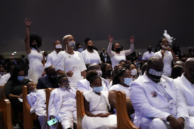 Family members react during the funeral service for George Floyd at the Fountain of Praise Church in Houston on Tuesday. (David J. Phillip/AP/Pool)
