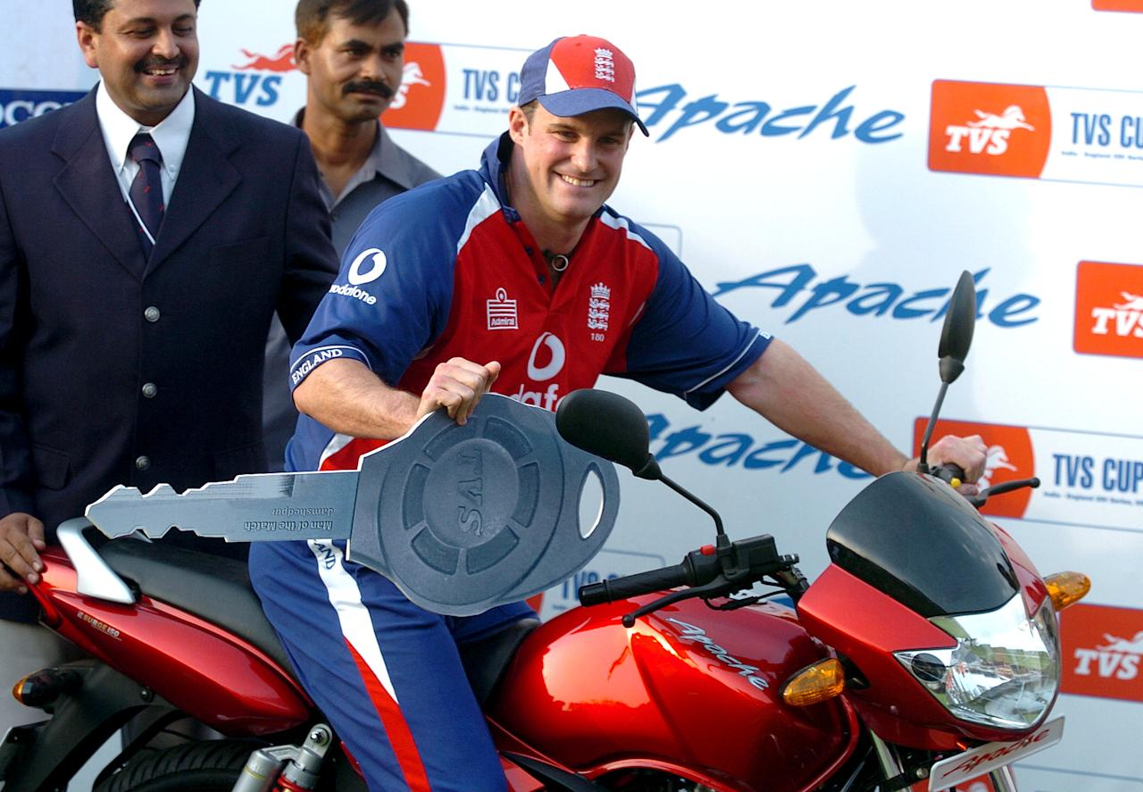 EnglISH cricketer Andrew Strauss (R) poses with the man of the match trophy, a motorbike, at the conclusion of the sixth One-Day International (ODI) cricket match between India and England at The Keenan Stadium in Jamshedpur, 12 April 2006.  England scored 227-5, winning by five wickets, following India's total of 223 runs all out.  India have an unassailable 4-1 lead in the seven match series.    AFP PHOTO/Deshakalyan CHOWDHURY