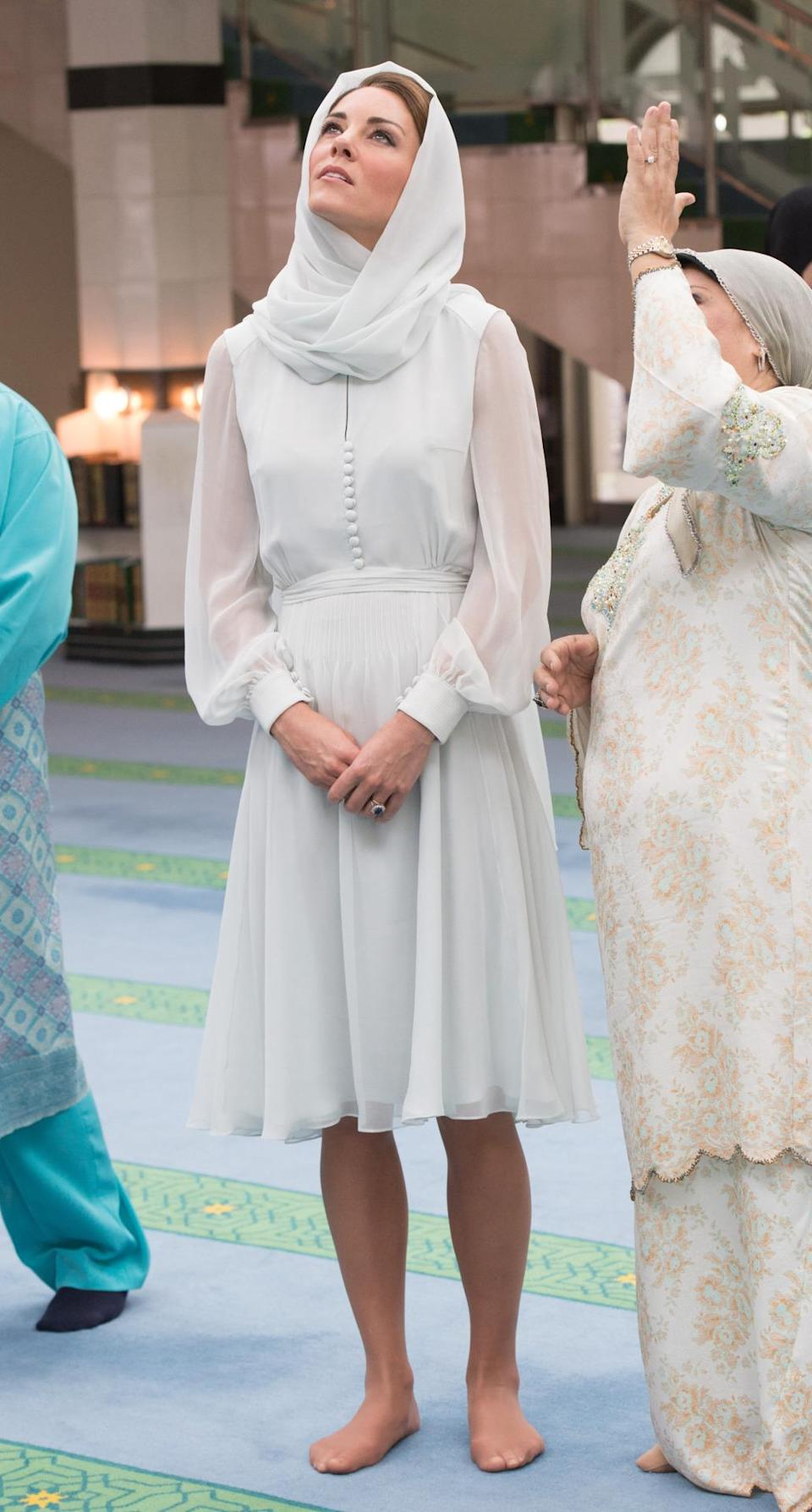 <p>Kate visited a mosque in Kuala Lumpur in a lightweight chiffon dress by Beulah London. </p><p><i>[Photo: PA]</i></p>