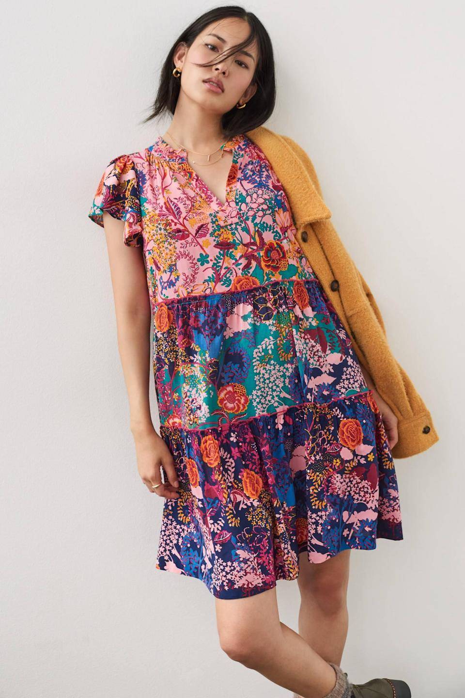 """<h2>Anthropologie Penrose Tiered Tunic Dress</h2><br>Anthropologie is beloved by readers for its dressed-up <em>je ne sais quoi</em> — everything in its sweet selection boasts a bold aesthetic and a bit of feminine flair. The retailer's dresses tended to skew on the pricier side, but we found possibly the most quintessentially Anthro dress we've ever seen — and it's a cool $98. This, along with a number of near-perfect 4-star reviews, is tipping this frock into our carts.<br><br><strong>Anthropologie</strong> Penrose Tiered Tunic Dress, $, available at <a href=""""https://go.skimresources.com/?id=30283X879131&url=https%3A%2F%2Fwww.anthropologie.com%2Fshop%2Fpenrose-tiered-tunic-dress%3Fcategory%3Ddresses%26color%3D066%26type%3DSTANDARD%26quantity%3D1"""" rel=""""nofollow noopener"""" target=""""_blank"""" data-ylk=""""slk:Anthropologie"""" class=""""link rapid-noclick-resp"""">Anthropologie</a>"""