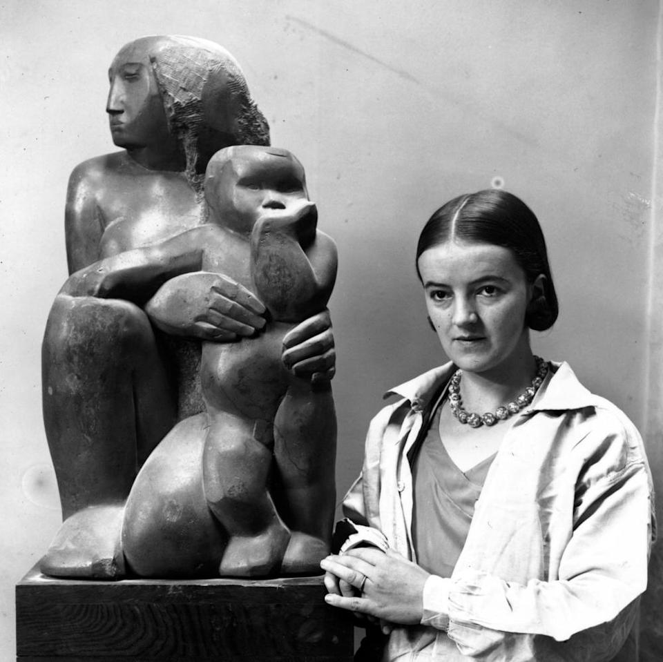 Barbara Hepworth with her sculpture Mother and Child.