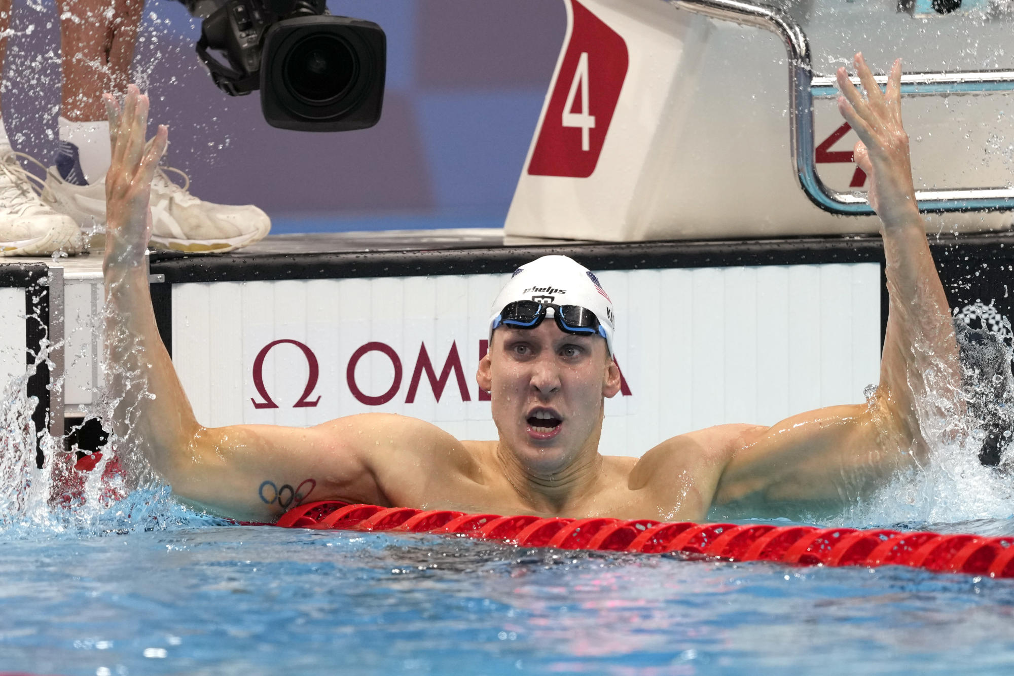 US starts off strong with 3 swim medals, including 1st gold