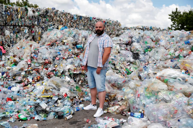 Wetter, 38-year-old, poses for a picture at a garbage disposal dump during the global coronavirus disease (COVID-19) outbreak, in Erd