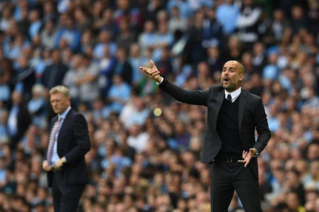 Manchester City's manager Pep Guardiola gestures from the touchline during the English Premier League match between City and Sunderland at the Etihad Stadium on August 13, 2016 (AFP Photo/Paul Ellis)