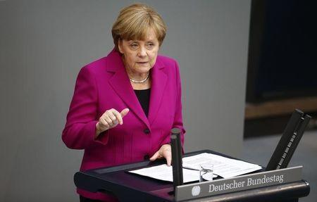 German Chancellor Angela Merkel addresses a session of the Bundestag, the lower house of Parliament, at the Reichstag in Berlin June 4 , 2014. REUTERS/Thomas Peter