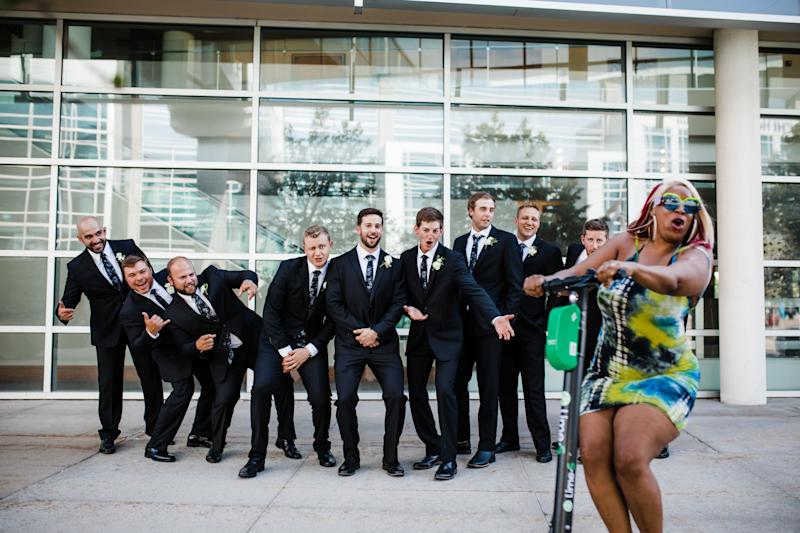 Kenyatta Jefferson rode in front of a groomsmen group photo on a Lime scooter in Omaha, Nebraska. (Credit: Photographers Molly and Joshua Giangreco from Molly B. Photography)