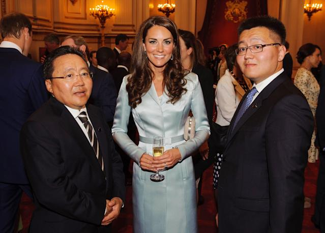 The Duchess of Cambridge with the President of Mongolia Elbegdorj Tsakhia, left, and Erdene Elbegdorj at a reception at Buckingham Palace, London, to welcome Heads of State and Heads of Government to the UK before they travel to the Olympic Stadium for the Opening Ceremony of the London 2012 Olympic Games, Friday July 27, 2012. (AP Photo / Dominic Lipinski)