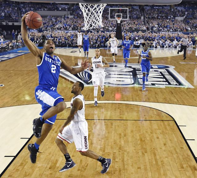 Kentucky guard Aaron Harrison (2) drives to the basket past Connecticut guard Ryan Boatright during the first half of the NCAA Final Four tournament college basketball championship game Monday, April 7, 2014, in Arlington, Texas. (AP Photo/Chris Steppig, pool)