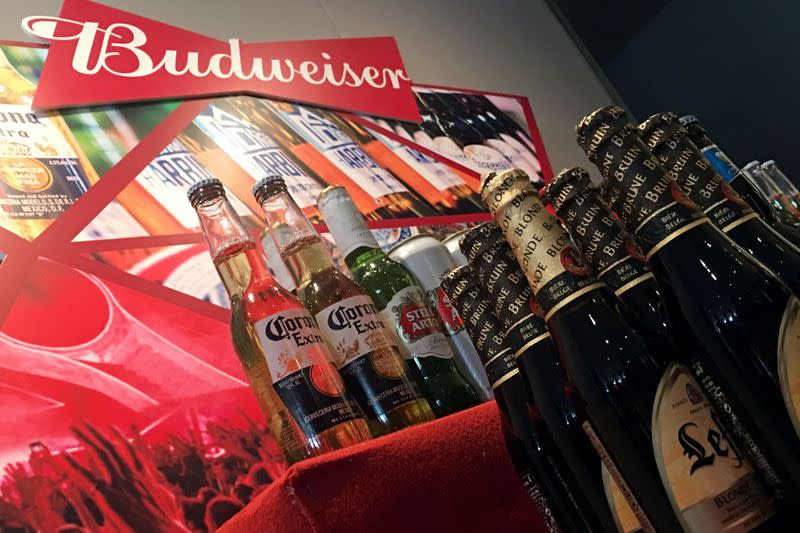 FILE PHOTO: Portfolio beer brands of Budweiser Brewing Company APAC Ltd are displayed during a news conference on the company's IPO in Hong Kong