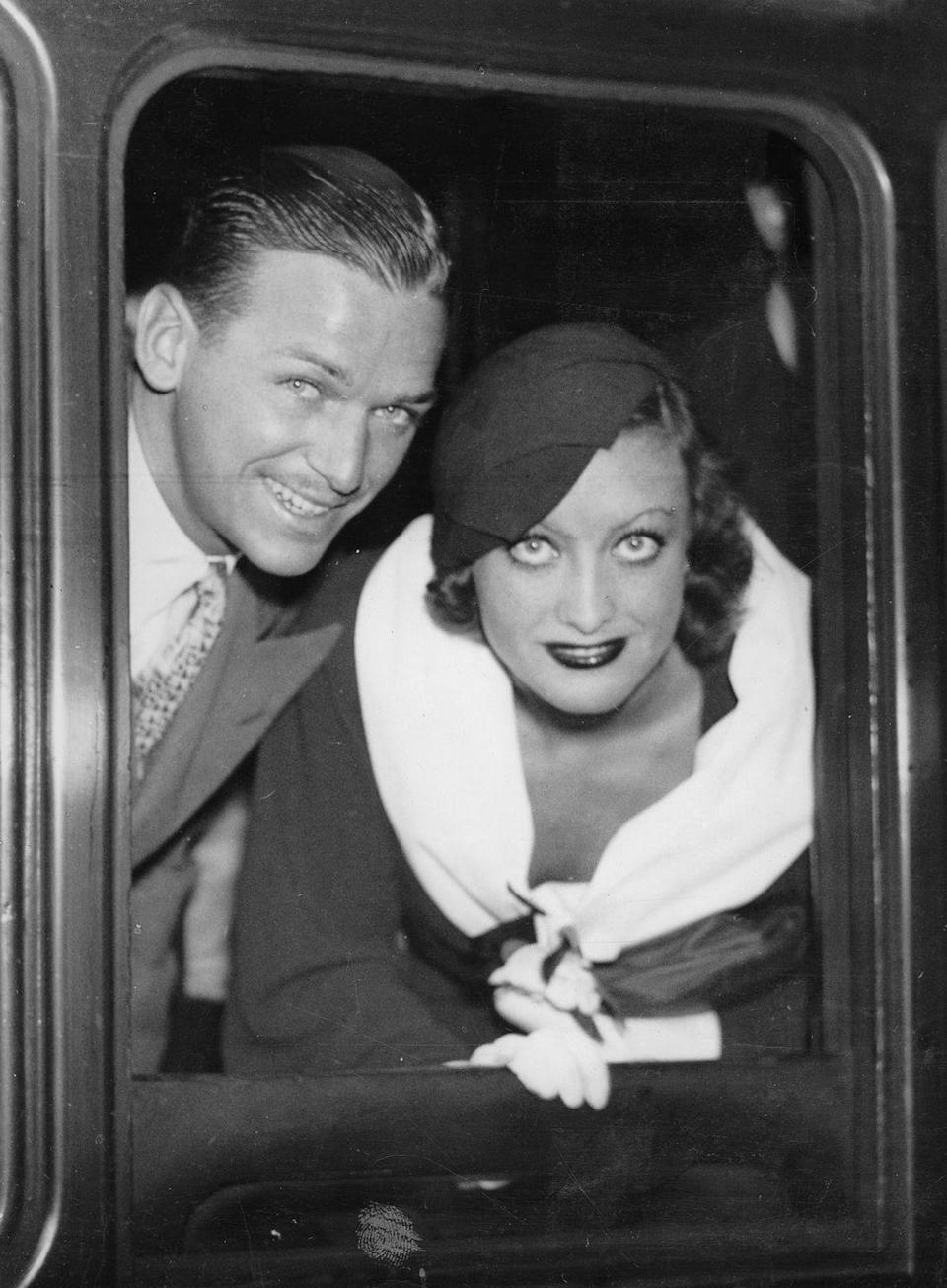 <p>Joan's first marriage came to an end when she and Douglas divorced in 1933. There were rumors of infidelity on both sides.</p>