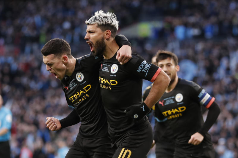 Manchester City's Sergio Aguero, right, celebrates with his teammate Phil Foden after scoring his side's first goal during the League Cup soccer match final between Aston Villa and Manchester City, at Wembley stadium, in London, England, Sunday, March 1, 2020. (AP Photo/Alastair Grant)