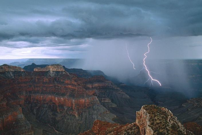 Lightning arcs into the Grand Canyon near Point Sublime on the North Rim. At least four people were injured after being struck by lightning while hiking in the Grand Canyon on Tuesday.