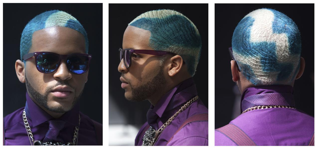 Reymundo Dominicci, an attendee, poses for a triptych of portraits during New York Fashion Week September 5, 2013. REUTERS/Carlo Allegri (UNITED STATES - Tags: FASHION PORTRAIT)
