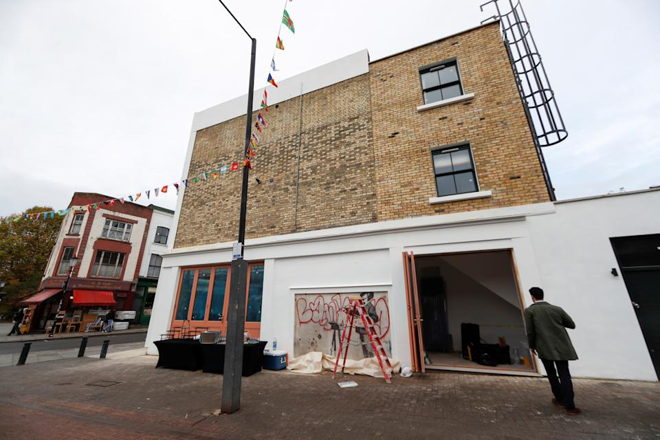 The flats in the development above the Banksy mural are on the market for £1 million (Picture: Reuters)