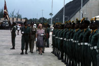Queen Elizabeth II inspecting a guard of honour mounted by the Barbados Regiment on her arrival in Bridgetown, Barbados, during her Silver Jubilee tour of the Caribbean.