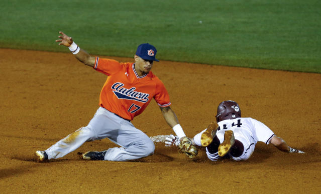 Texas A&M's George Janca (44) beats the tag of Auburn shortstop Will Holland (17) as he steals second during the third inning of a Southeastern Conference tournament NCAA college baseball game Thursday, May 24, 2018, in Hoover, Ala. (AP Photo/Butch Dill)