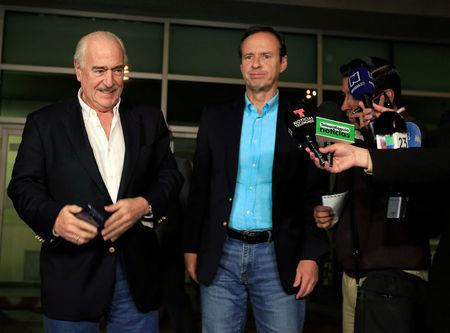 Former Colombian President Andres Pastrana and former Bolivian President Jorge Quiroga give statements to the media after they said they were denied entry to Cuba, at the airport in Bogota, Colombia March 7, 2018. REUTERS/Jaime Saldarriaga