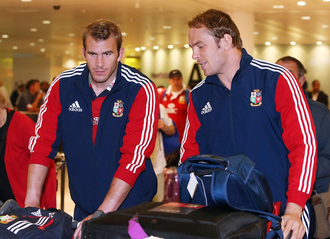 Tom Croft (left) and Alun Wyn Jones of the British and Irish Lions, arrive at Heathrow Airport, following their Test series triumph against Australia, just hours before the England cricket team pick up the baton.