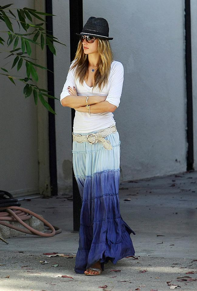 "Victoria's Secret model Alessandra Ambrosio shows off her bohemian side in a tiered skirt, braided belt, and funky straw fedora. Ahmad Elatab/Saleem Elatab/<a href=""http://www.splashnewsonline.com/"" target=""new"">Splash News</a> - July 5, 2009"