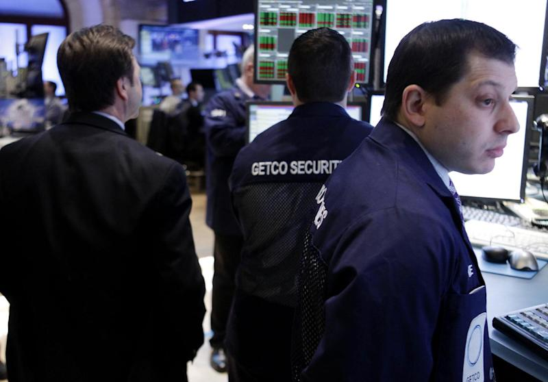 In this Feb. 21, 2012 photo, traders work on the floor at the New York Stock Exchange. Markets were subdued Thursday, Feb. 23, 2012, as Greece pressed ahead with reforms demanded by its creditors in exchange for crucial bailout cash and as tensions rose in the Persian Gulf over Iran's nuclear program.  (AP Photo/Seth Wenig)
