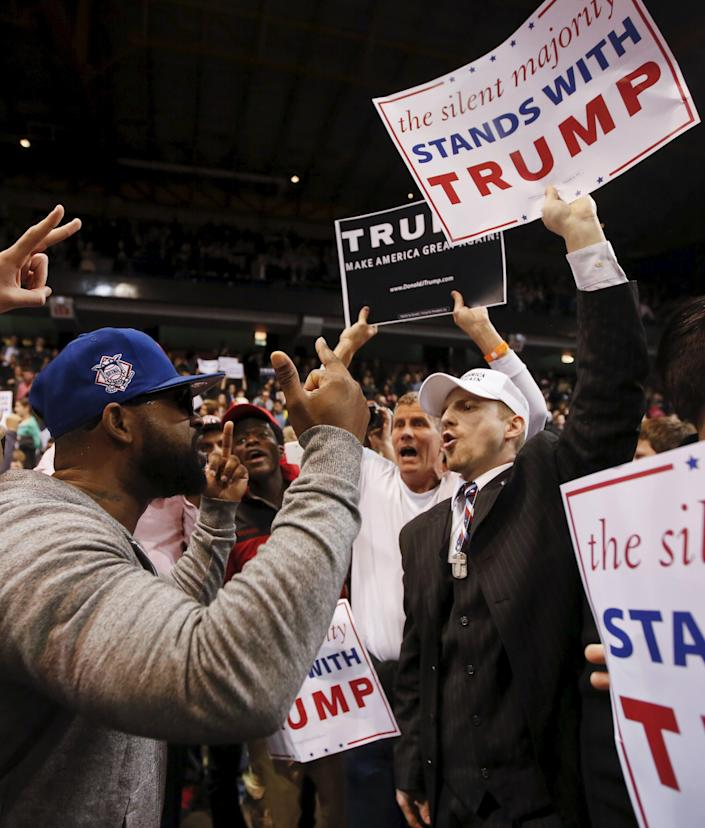 Trump supporter (R) exchanges words with a demonstrator (L) after Republican U.S. presidential candidate Donald Trump cancelled his rally at the University of Illinois at Chicago March 11, 2016. (REUTERS/Kamil Krzaczynski)