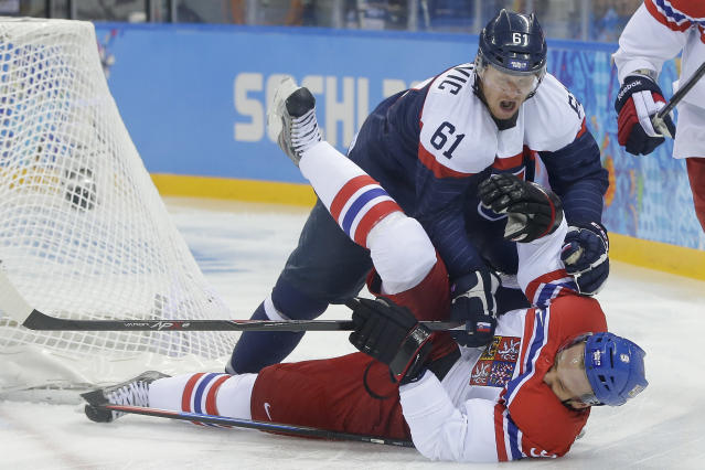 Slovakia forward Milan Bartovic collides with Czech Republic forward Milan Michalek during the first period of the 2014 Winter Olympics men's ice hockey game at Shayba Arena, Tuesday, Feb. 18, 2014, in Sochi, Russia. (AP Photo/Matt Slocum)