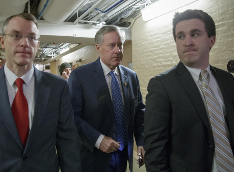House Freedom Caucus Chairman Rep. Mark Meadows, R-N.C., center, rushes to a caucus in the basement of the Capitol in Washington, Friday, March 24, 2017, before House Speaker Paul Ryan of Wis. announced that he is abruptly pulling their troubled health care bill off the House floor. (AP Photo/J. Scott Applewhite)