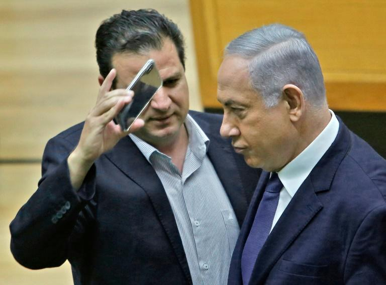 Ayman Odeh put his phone in Prime Minister Benjamin Netanyahu's face at Israel's parliament in Jerusalem to protest at a bill that would have allowed party officials to take cameras to polling stations