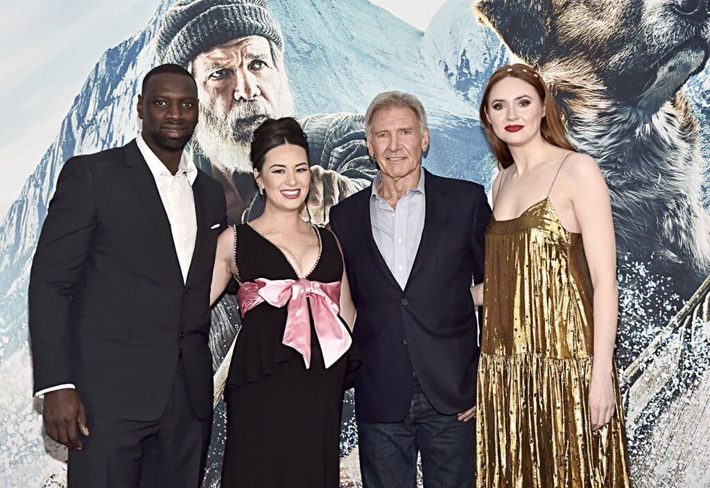 """The <a href=""""https://ew.com/movies/2019/11/20/call-of-the-wild-trailer-harrison-ford/""""><em>Call of the Wild</em></a> stars Omar Sy, Cara Gee, <a href=""""https://ew.com/tag/harrison-ford/"""">Harrison Ford</a>, and Karen Gillan posed together at the film's world premiere at the El Capitan Theatre in Hollywood on Feb. 13."""