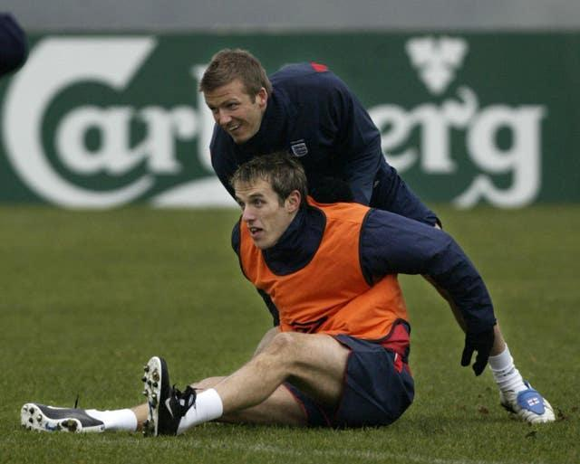 David Beckham (top) with Phil Neville are former team-mates with England and Manchester United