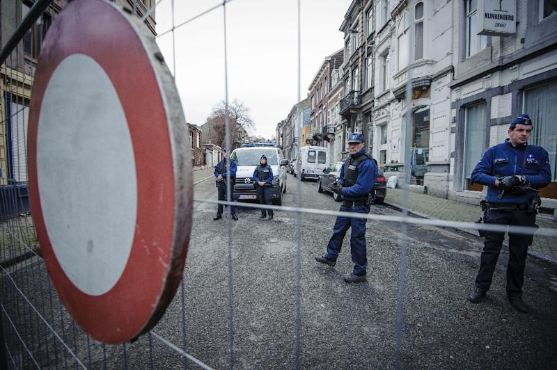 Belgian police guard a street in Verviers after a raid on a suspected terror cell in January 2015 in which two suspects were killed