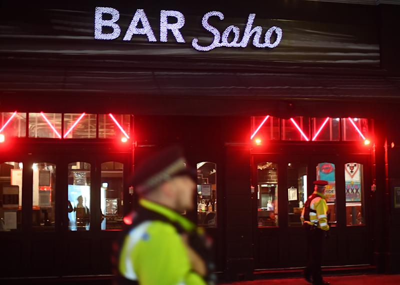 Police officers outside Bar Soho in London, after a range of new restrictions to combat the rise in coronavirus cases came into place in England.