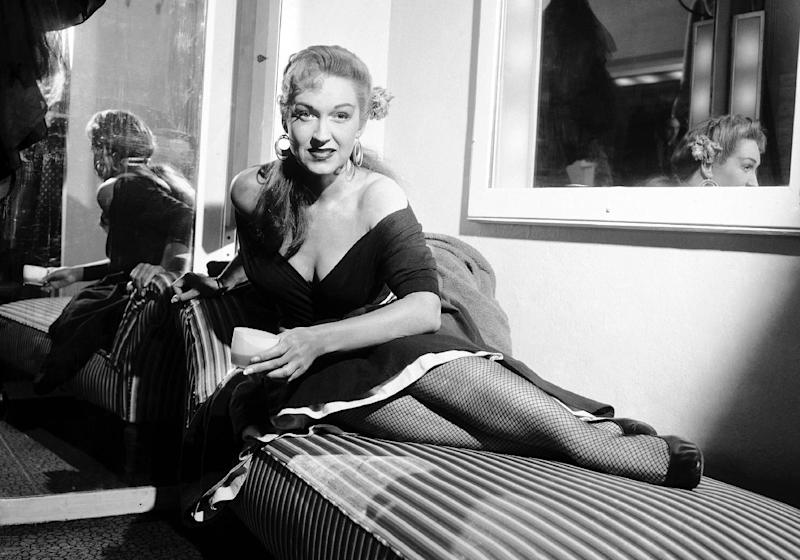 """FILE - This April 3, 1954 file photo shows opera singer Rise Stevens in her dressing room at the Metropolitan Opera House in New York before performing in """"Carmen.""""  Stevens, who sang with the Metropolitan Opera for more than 20 years spanning the 1940s and 1950s, died Wednesday, March 20, 2013 at her Manhattan home.  She was 99. (AP Photo/Jack Harris, file)"""