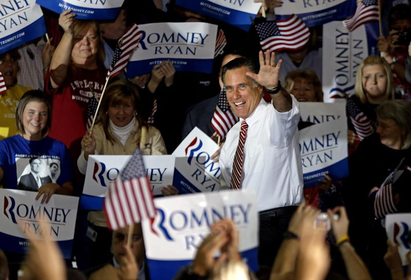 Republican presidential candidate, former Massachusetts Gov. Mitt Romney waves as he takes the stage for a campaign event at a window and door factory, Thursday, Nov. 1, 2012, in Roanoke, Va. (AP Photo/David Goldman)
