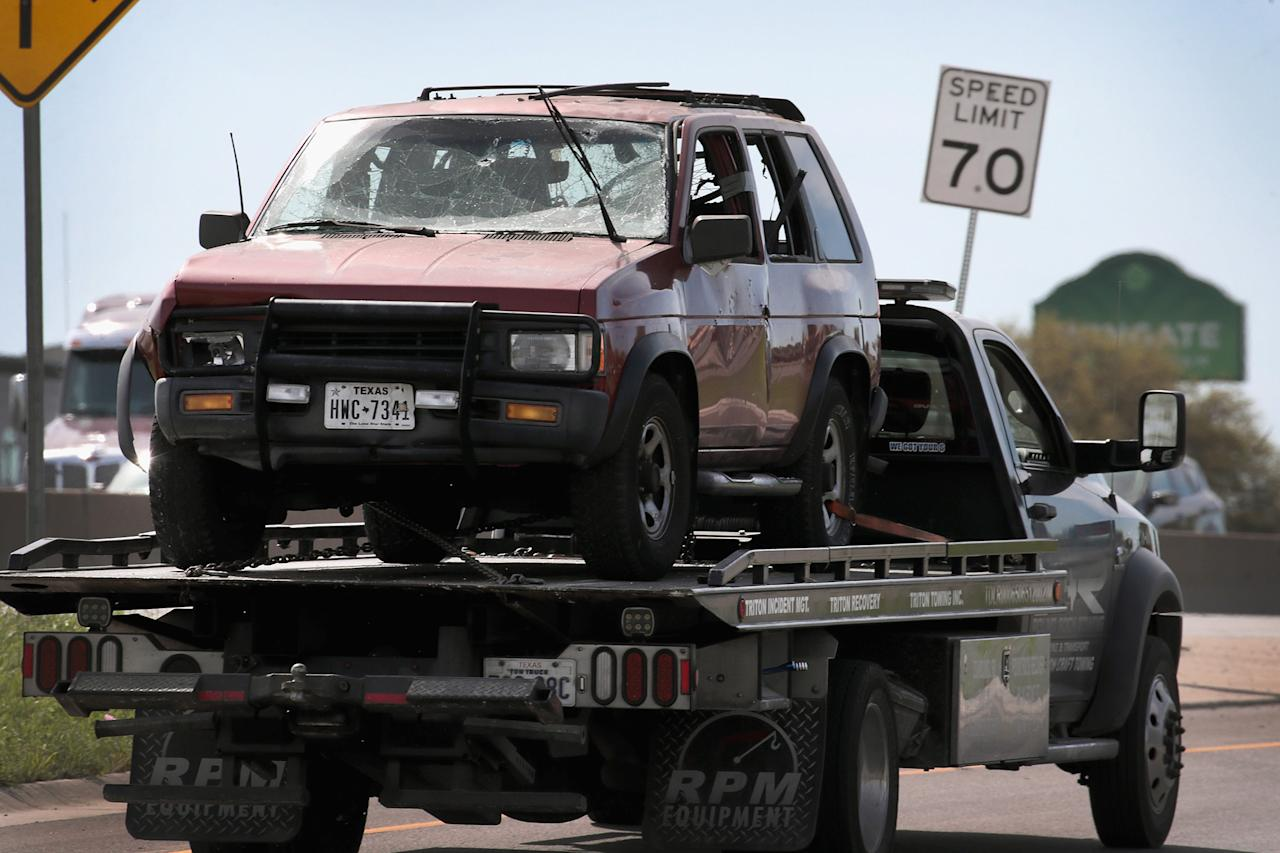 <p>The vehicle that the Austin package bomber, Mark Anthony Conditt, was driving when he blew himself up is towed from the crime scene along Interstate 35 in suburban Austin on March 21, 2018 in Round Rock, Texas. (Photo: Scott Olson/Getty Images) </p>