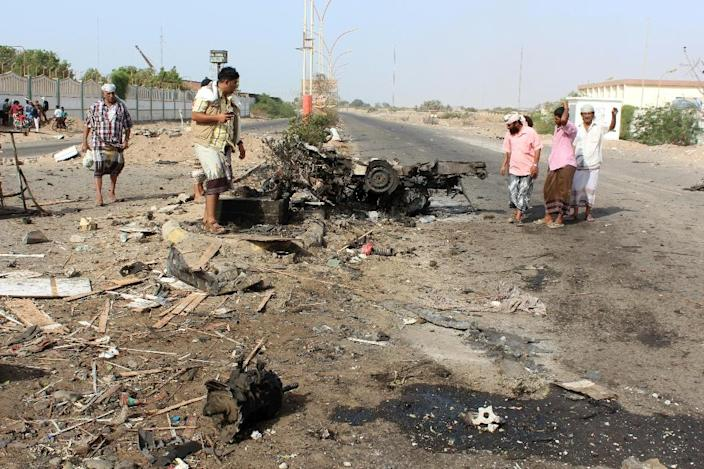 Yemenis gather on March 26, 2016 at the site of a suicide bomb attack that struck the day before checkpoints of Yemeni loyalist forces in Shaab district, on Aden's western outskirts (AFP Photo/Saleh Al-Obeidi)