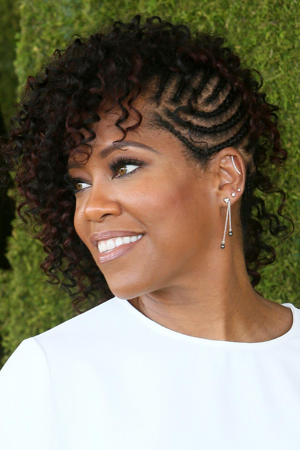 """<p>Pair your curls with intricate cornrows. Actress <strong>Regina King</strong> mixes it up by tightly braiding one side of her hair and leaving the rest to cascade in <a href=""""https://www.goodhousekeeping.com/beauty/hair/tips/g201/celebrity-hairstyles-curly/"""" rel=""""nofollow noopener"""" target=""""_blank"""" data-ylk=""""slk:beautiful ringlets"""" class=""""link rapid-noclick-resp"""">beautiful ringlets</a>.</p>"""