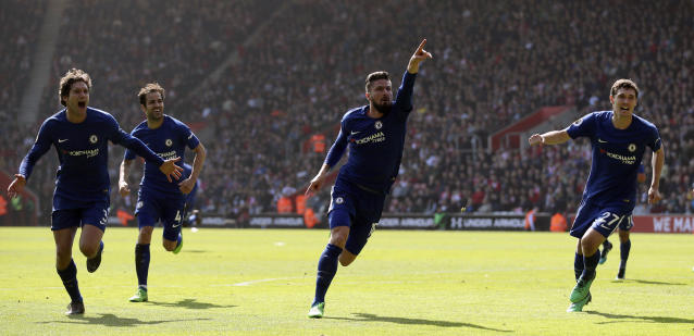 Chelsea's Olivier Giroud, center, celebrates scoring his side's third goal of the game during their English Premier League soccer match against Southampton at St Mary's Stadium, Southampton, England, Saturday, April 14, 2018. (Adam Davy/PA via AP)
