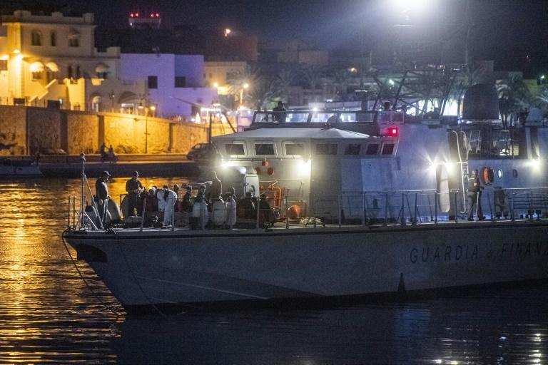 Italian authorities identified and carried out medical checks on the African migrants after they disembarked overnight on southern island Lampedusa after more than six days at sea