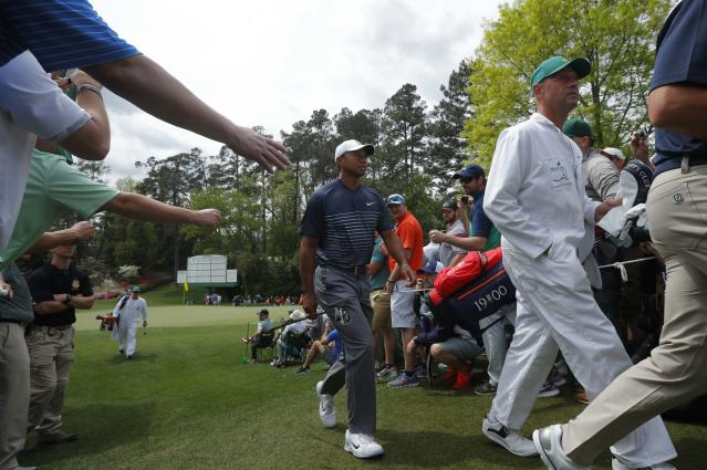 Tiger Woods of the U.S. walks to the 7th tee during the final day of practice for the 2018 Masters golf tournament at Augusta National Golf Club in Augusta, Georgia, U.S. April 4, 2018. REUTERS/Brian Snyder