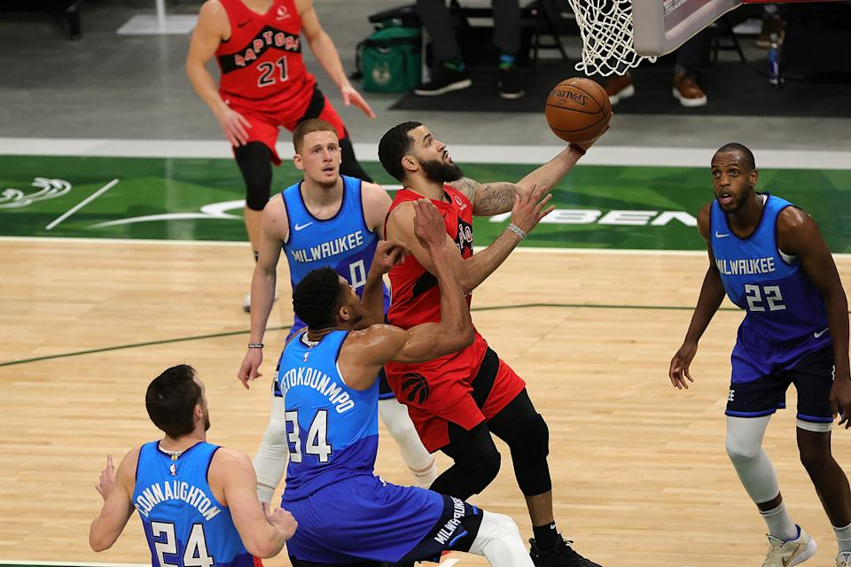 Fred VanVleet scores during the Raptors' win over the Bucks. (Photo by Stacy Revere/Getty Images)