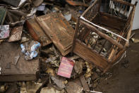 Damaged household items are piled in a street after flooding in Ensival, Verviers, Belgium, Friday July 16, 2021. Severe flooding in Germany and Belgium has turned streams and streets into raging torrents that have swept away cars and caused houses to collapse. (AP Photo/Francisco Seco)