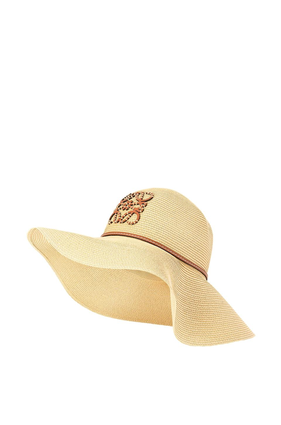 """<p><strong>loewe</strong></p><p>loewe.com</p><p><strong>$550.00</strong></p><p><a href=""""https://www.loewe.com/usa/en/women/accessories/hats-and-hair-accessories/capeline-hat-in-natural-fibre-and-calfskin/K820295X38-2123.html?cgid=w_hats_hair_accessories&p=15"""" rel=""""nofollow noopener"""" target=""""_blank"""" data-ylk=""""slk:Shop Now"""" class=""""link rapid-noclick-resp"""">Shop Now</a></p><p>Along with sunscreen, a good sunhat is your best friend this summer, plus this one from Loewe is especially stylish!</p>"""