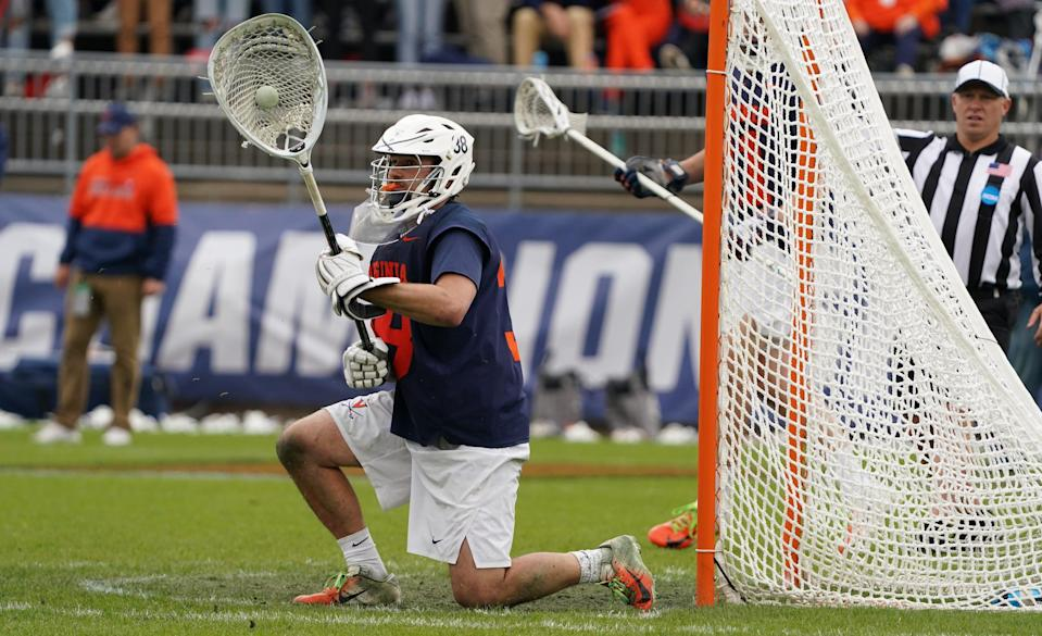 Virginia goalie Alex Rode makes a save against Maryland during the second half NCAA Div. I men's lacrosse championship.
