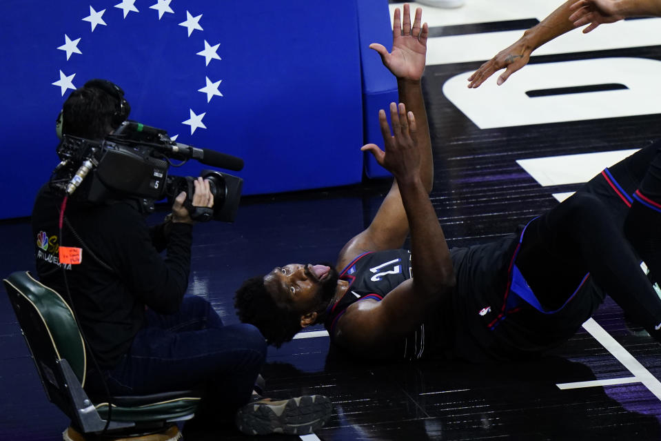 Philadelphia 76ers' Joel Embiid reacts after being fouled during the first half of Game 2 in a first-round NBA basketball playoff series against the Washington Wizards, Wednesday, May 26, 2021, in Philadelphia. (AP Photo/Matt Slocum)