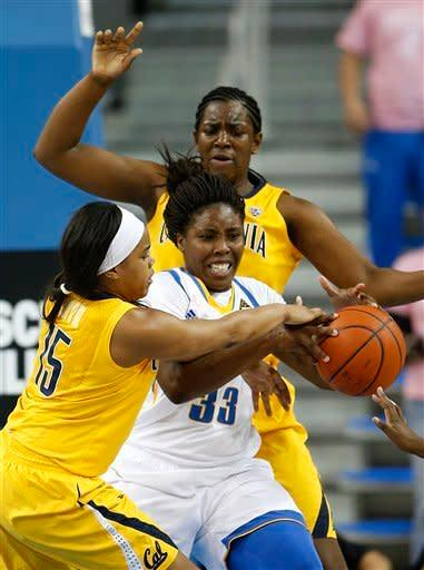 UCLA forward Jasmine Dixon, center, is defended by California guard Brittany Boyd, left, and Talia Caldwell during the first half of an NCAA college basketball game in Los Angeles, Friday, Feb. 15, 2013. (AP Photo/Jae C. Hong)