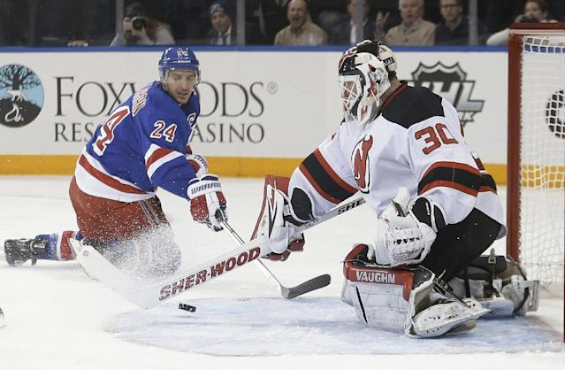 New Jersey Devils goalie Martin Brodeur (30) stops a shot by New York Rangers' Ryan Callahan (24) during the second period of an NHL hockey game Tuesday, Nov. 12, 2013, in New York. (AP Photo/Frank Franklin II)