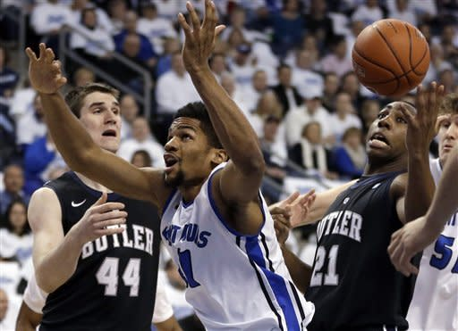 Butler's Roosevelt Jones, right, and Saint Louis' Dwayne Evans, center, try to grab a loose ball as Butler's Andrew Smith, left, watches during the first half of an NCAA college basketball game Thursday, Jan. 31, 2013, in St. Louis. (AP Photo/Jeff Roberson)