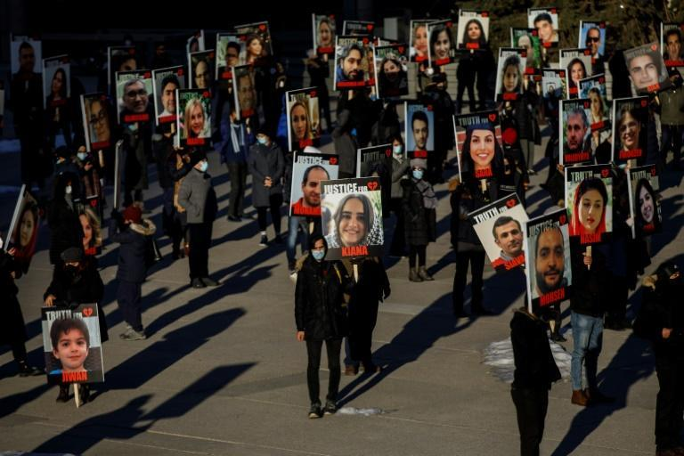 People take part in a march in memory of the victims of downed Ukraine International Airlines flight PS752, which was shot down near Tehran by Iran's Revolutionary Guard, in Toronto, Ontario, Canada, on January 8, 2021