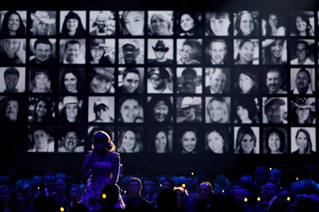 Carrie Underwood performs a tribute to those in the country music community who died in 2017. Her tribute included the 58 victims killed in the Las Vegas shooting. (Taylor Hill via Getty Images)